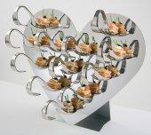 Elegancki zestaw do serwowania zakąsek. Wykonany ze stali nierdzewnej.
